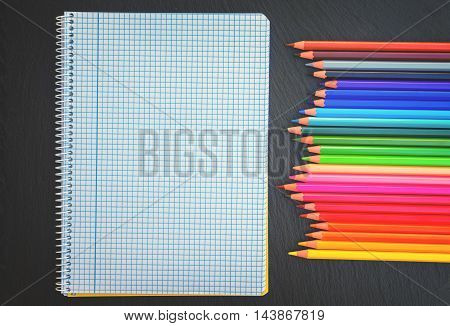 Back to school pencils rainbow and ruled notebook, retro toned