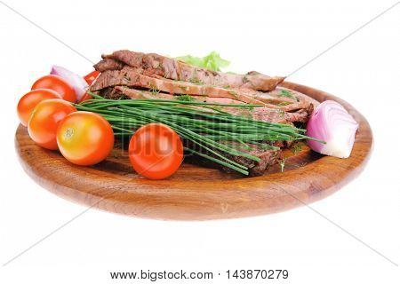 hot beef on wooden plate over white