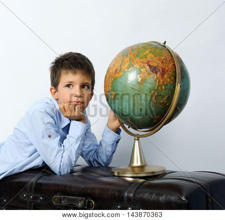 boy with vintage globe