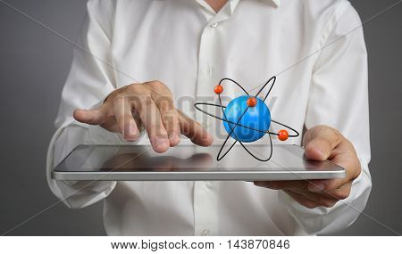 Man scientist holding a tablet PC with atom model, research concept