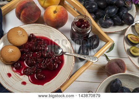 Colorful Fruit Set Of Purple, Red And Orange Background In Bowls. Plum, Peaches, Watermelon Sliced A