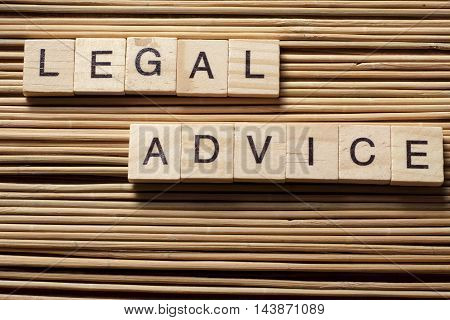 Legal Advice word written on wood block. Wooden ABC