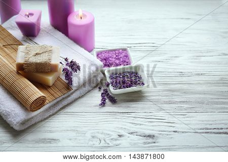 Spa composition with lavender and candles on white wooden background