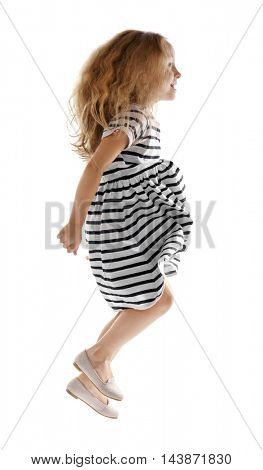 Cheerful little girl jumping on white background