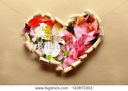 Torn paper  with flowers background. Love concept.