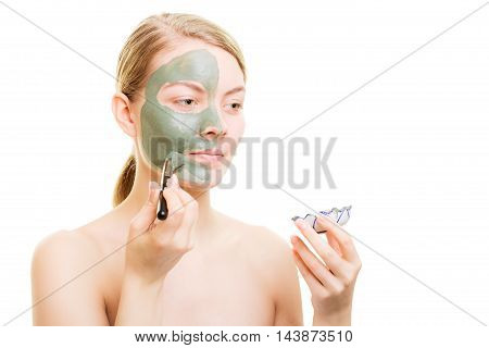 Girl Applying Facial Clay Mask To Her Face