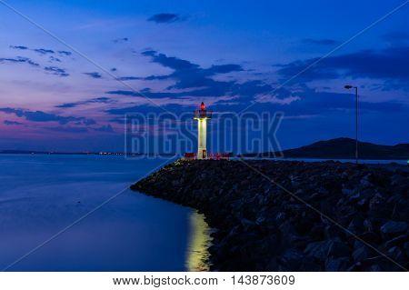 Purple Twilight Ocean Reflection Lighthouse on Rocks Howth Ireland