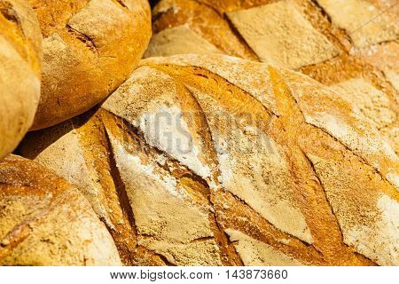 Many Brown Rustic Fresh Rye Bread Loaves As Food Background