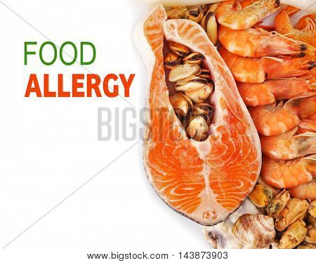 Allergy danger concept. Seafood with text food allergy on white background.