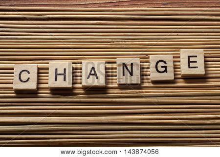 text of CHANGE on wood abc cubes at wooden background