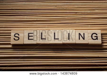 word of SELLING on wood abc cubes at wooden background