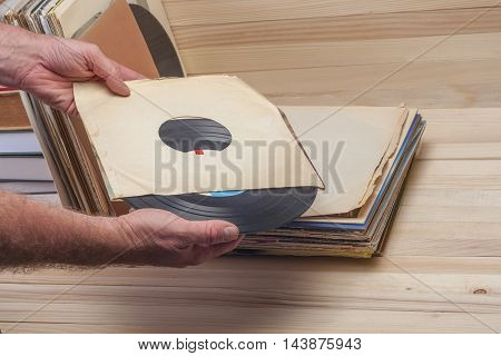 Browsing Through Vinyl Records Collection. Music Background. Copy Space
