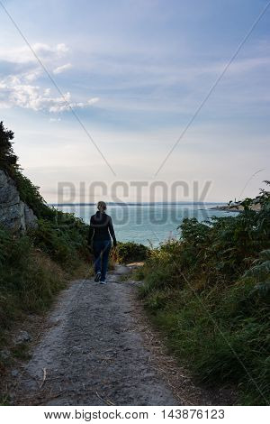 Woman Walking Along Rocky Path Cliff Howth Harbor Landscape
