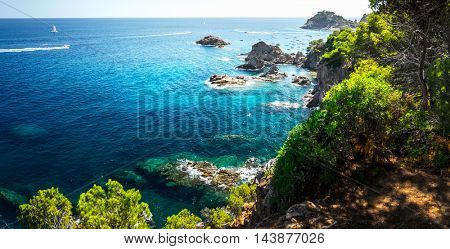 Coast of the sea with rocks near the town of Tossa de Mar, Spain