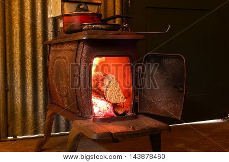a burning fire in an old-fashioned stove