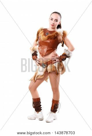 Young professional cheerleader dressed in a warrior costume posing at studio. Isolated over white.