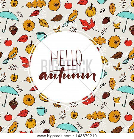 Hello autumn text in round frame on hand drawn fall background with umbrella, orange leaves and pumpkins