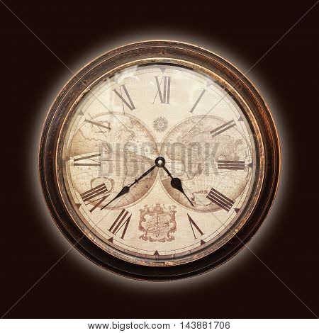 Clock - Vintage mechanical wall clock on brown background.