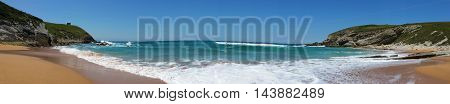Beach With Beautiful Waves And Blue Sky, Landscape. North Spain