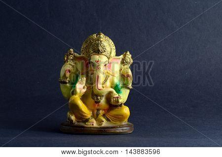 Hindu God Ganesha. Ganesha Idol on dark Background.