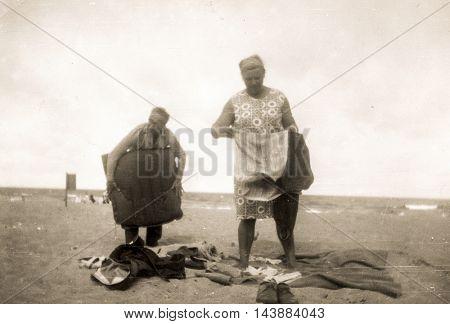 Vintage photo of couple on beach, 1960's