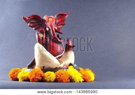 Hindu God Ganesha. Ganesha Idol on grey Background.