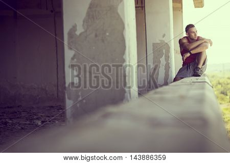 Muscular athletic built young athlete resting after a hard workout
