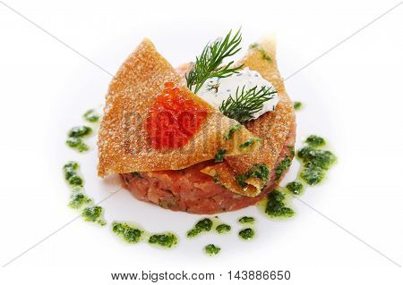 Tartar of smoked salmon with spicy cream cheese celery and red caviar