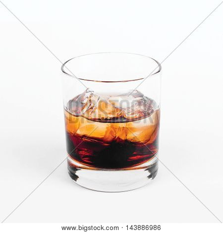Black Russian vodka with ice in glass on white background