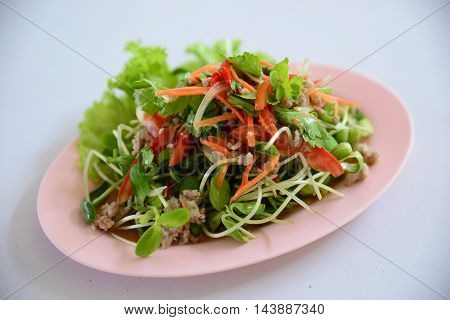 Special salad of minced beef lectuce cumin and herbs on white plate