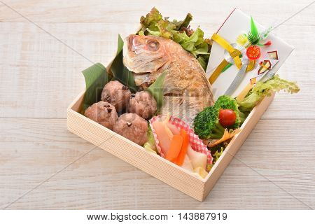 Special gift box with fried snapper fish broccoli lettuce and rice ball