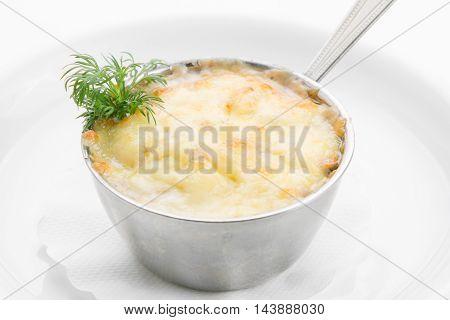 Delicate mushrooms in cream sauce on white background
