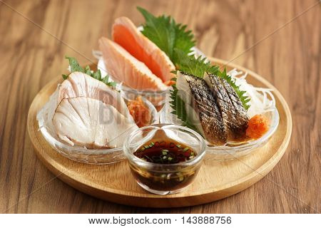 Varieties of grilled fish set fire to at least three fish cooked over a small surface to flavor concentration.