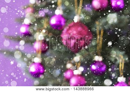 Blurry Christmas Tree With Rose Quartz Balls. Bokeh Effect And Snowflakes For Winter Atmosphere. Close Up Or Macro View. Christmas Card For Seasons Greetings.