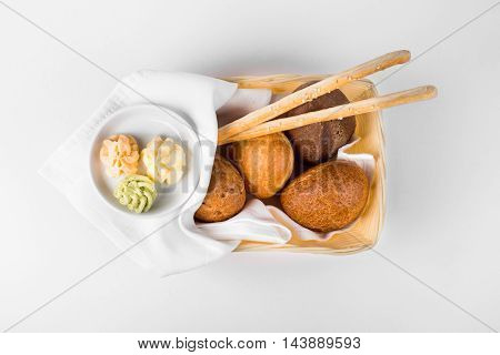 Russian bread of Corzine Hlebnaya in bamboo tray with tablecloth on white background