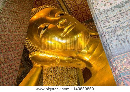 Close up Reclining Buddha gold statue Wat Pho Bangkok Thailand