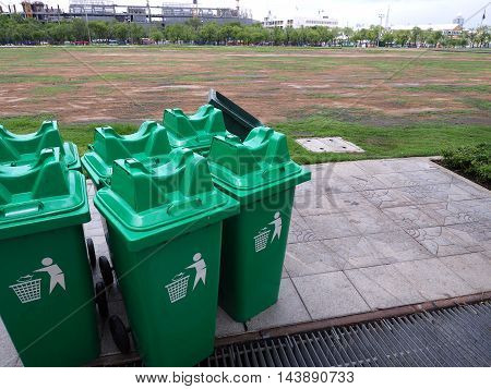 Group of green bins for general waste in plaza