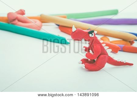 Creative Red Dinosaur Clay Model. Play Dough Animal. Vintage Tone Effect.