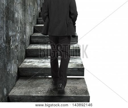 Businessman Walking Up The Old Concrete Stairs