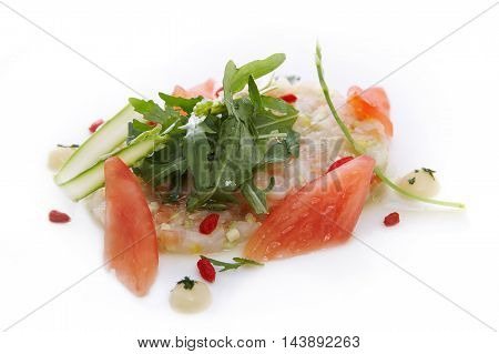 Tartare of scallops with tomato and mango juice and yuzu on white background