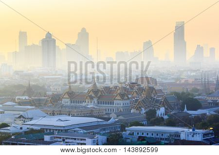 Grand Palace and Emerald Buddha Temple (Wat Phra Kaew) at morning sunrise time of winter covered with mist Bangkok Thailand