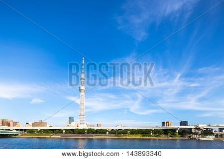 tokyo tower in blue sky from water