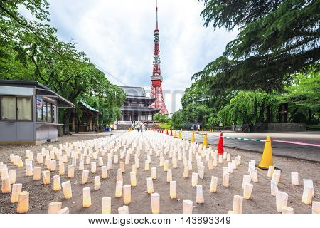 square with many candles near tokyo tower