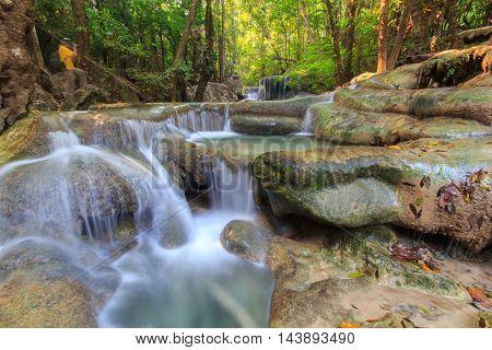 Deep forest waterfall at Erawan waterfall National Park Kanchanaburi Thailand
