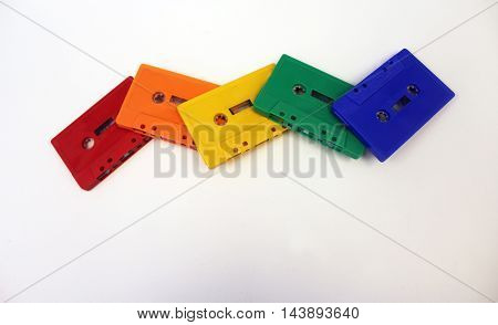 Eighties old school cassette tapes rainbow pattern isolated white background