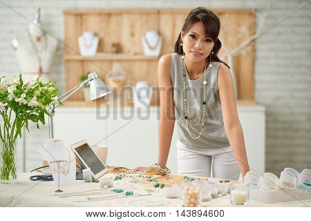 Portrait of female entrepreneur in her design studio