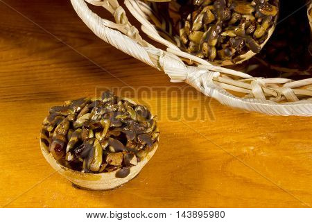 Sunflower seeds Cookies with chocolate in waffle basket on a wooden background