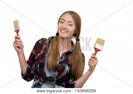 woman holding a paint brush. tools for repair and painting