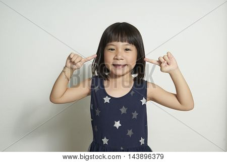 Cute little girl with index finger up