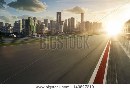 Motion blurred racetrack , morning scene .